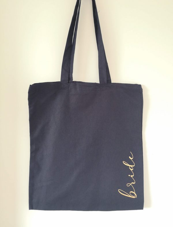 Navy blue tote bag with the word brid in gold vinyl lettering