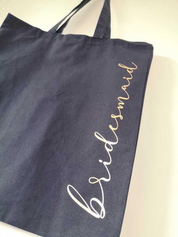 Navy tote bag with bridesmaid in gold lettering