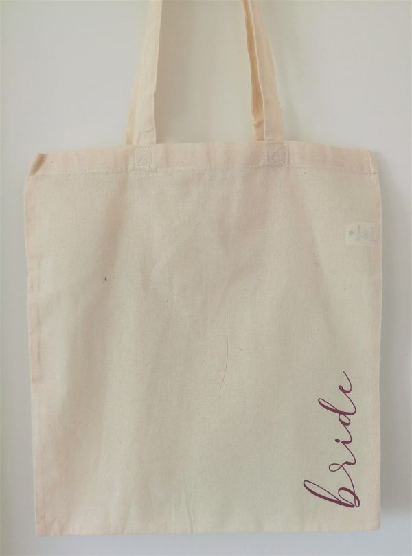 Natural coloured tote bag with the word bride in pink lettering