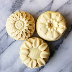 Three lemongrass soaps in the shape of flowers